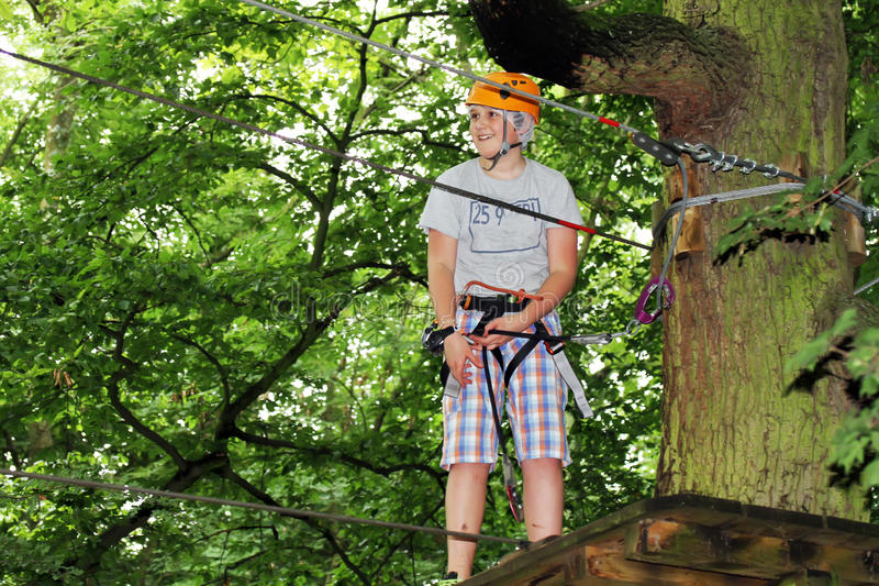 Young boy engaged in climbing royalty free stock images