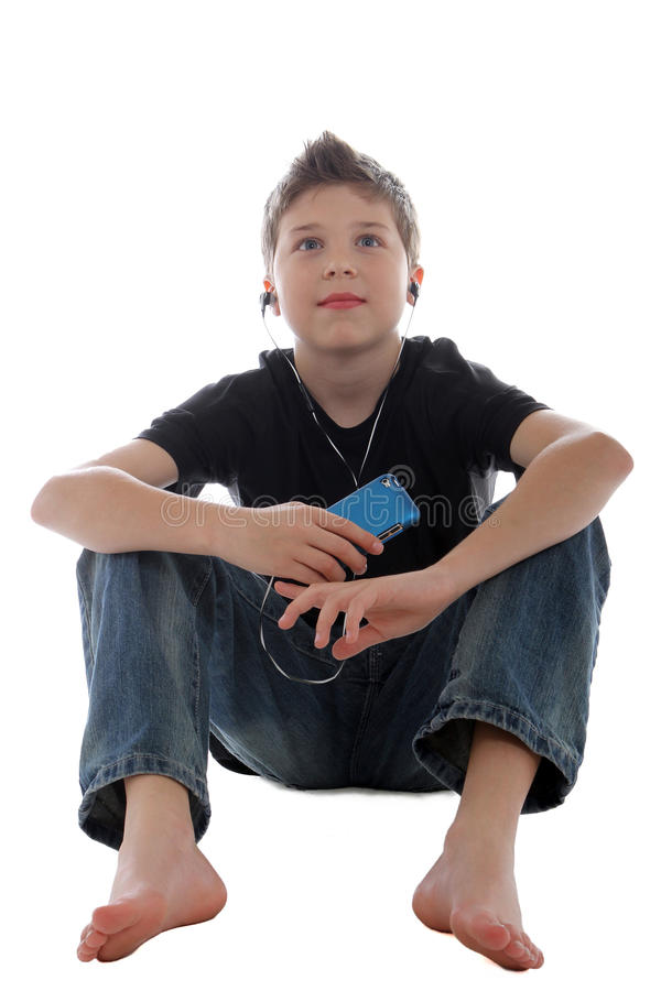 Download Young boy enjoying music stock photo. Image of earbuds - 22014206