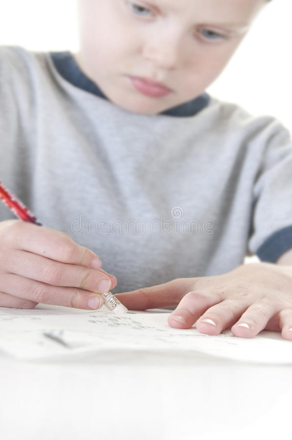 Young Boy Erasing Mistake Royalty Free Stock Image