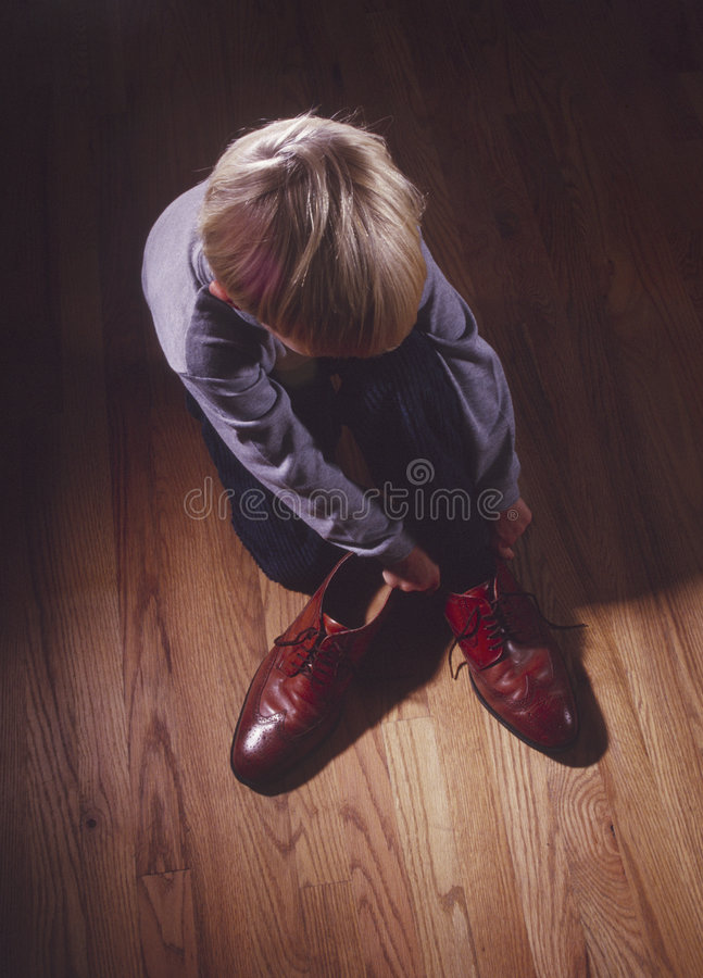 Download Young Boy With Father's Shoes Stock Photo - Image: 5948774