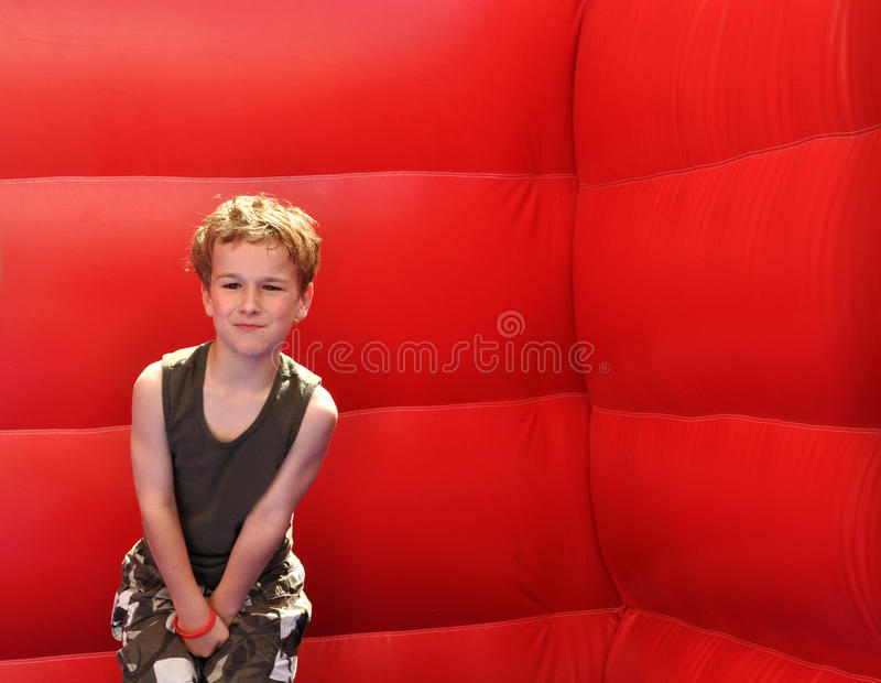 Young boy feeling hurt below the belt royalty free stock photography