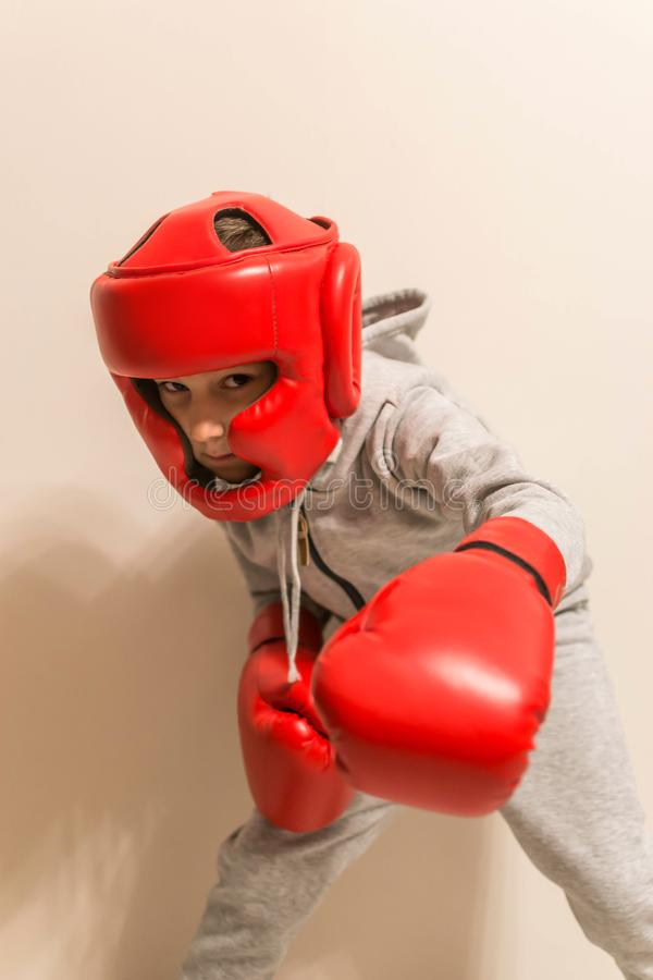 Young boy fighter boxer in various postures defense. Sport photo royalty free stock photo