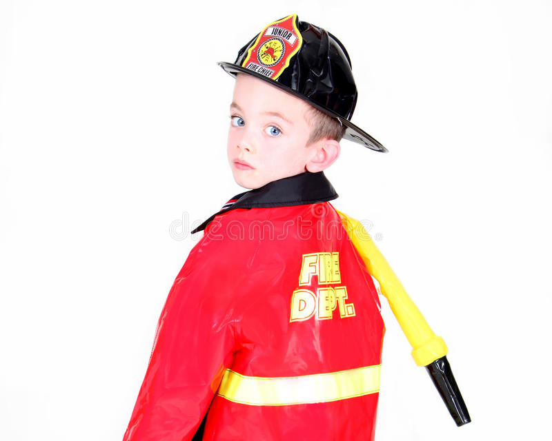 Young boy in fireman costume royalty free stock photography