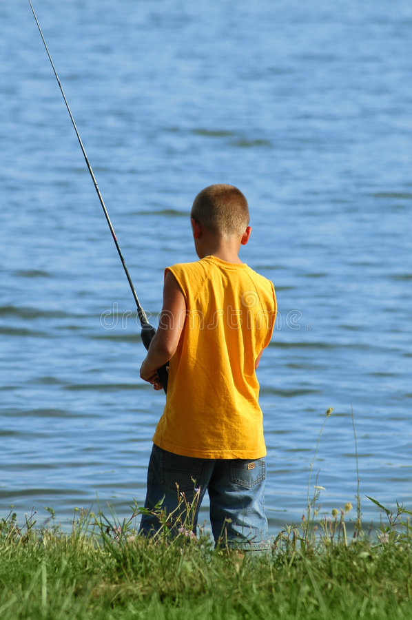 Young boy fishing stock photography