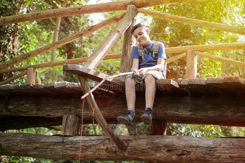 Young boy fishing in the woods stock image