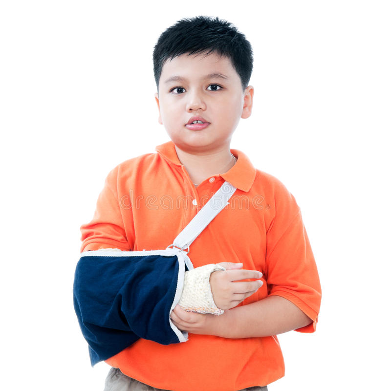 Young Boy With Fractured Hand In Plaster Cast. Portrait of a young Asian boy with fractured hand in plaster cast, isolated on white background stock photography
