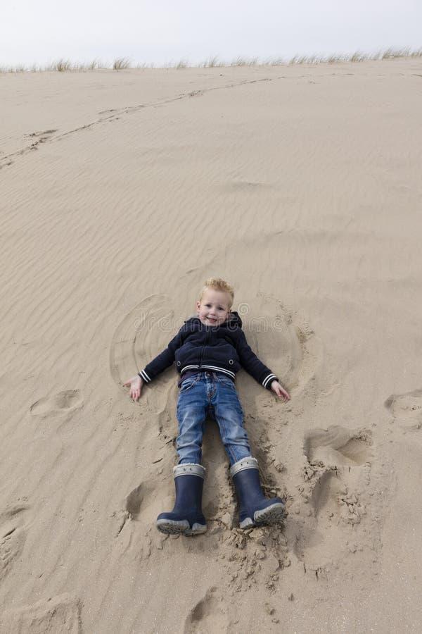 Young Boy Fun At Dutch Dunes royalty free stock photos