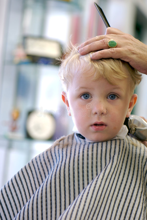 Young Boy getting a haircut royalty free stock photos