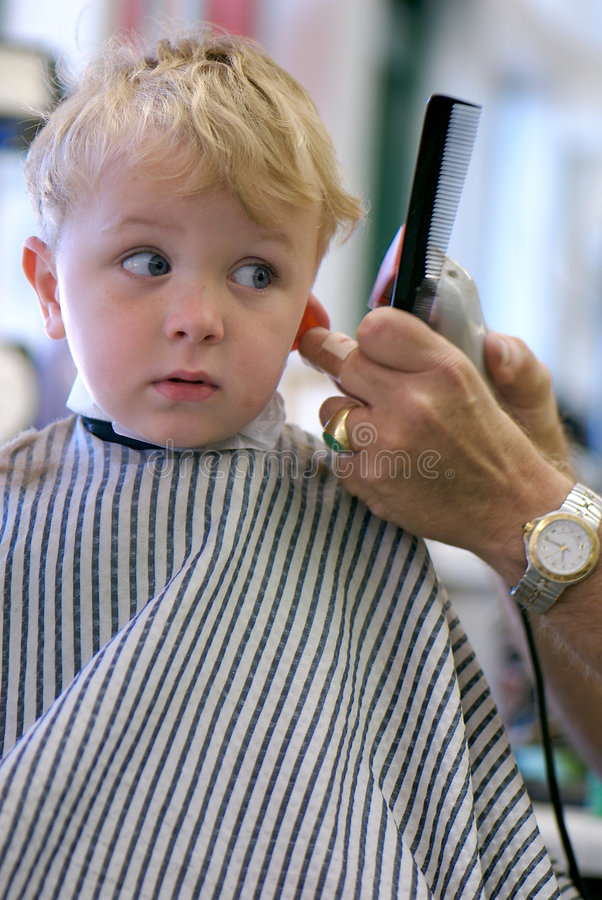Young Boy getting a haircut royalty free stock photography
