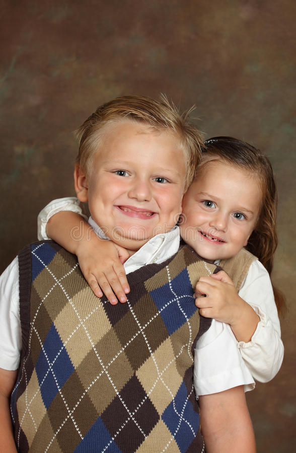 Young boy and girl. Young Beautifull Girl and Handsome boy, studio shot royalty free stock image