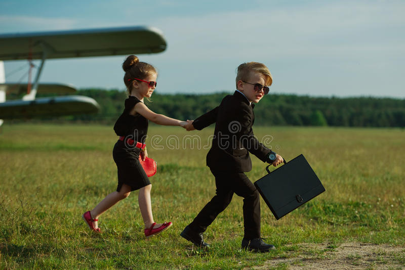Young boy and girl playing spy royalty free stock photos