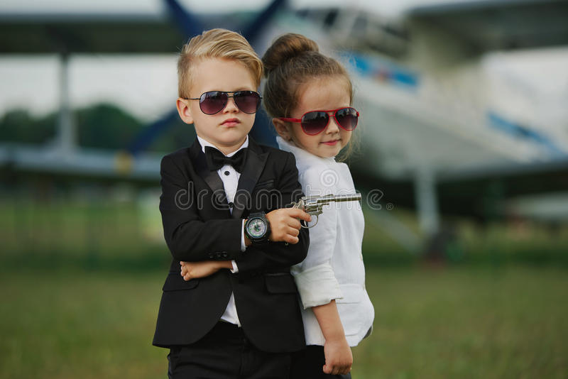 Young boy and girl playing spy stock photography