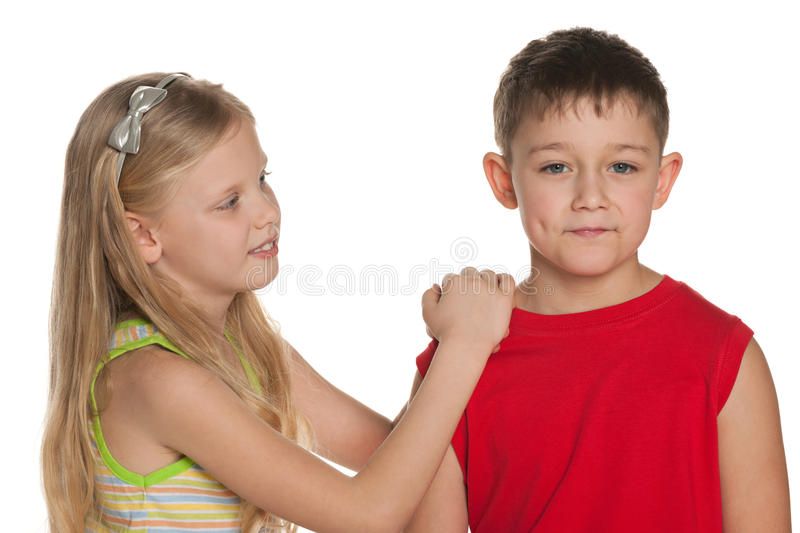 Young boy and girl are standing together. On the white background royalty free stock photography