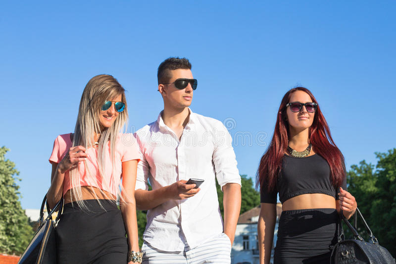 Young boy with girls walking royalty free stock photos