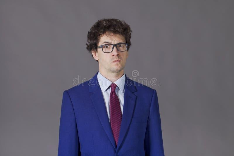 Emotional boy in blue jacket stock photos