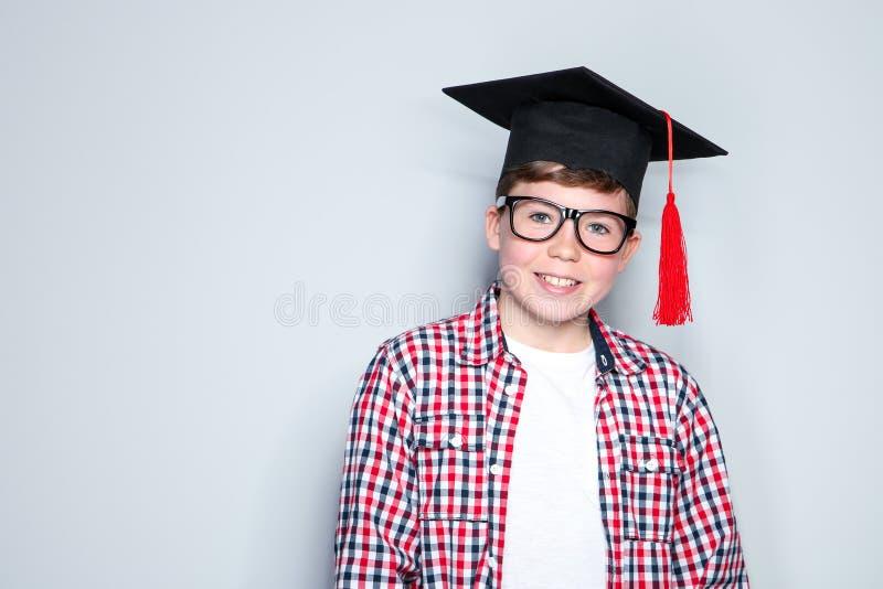 Boy in graduation cap stock image