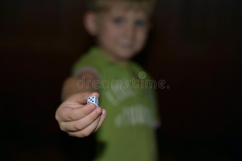 Young boy hand showing dice royalty free stock images
