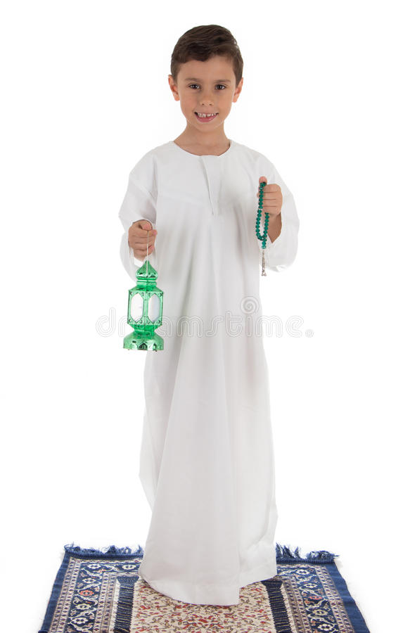 Young boy happily catching Ramadan lantern and rosary stock image