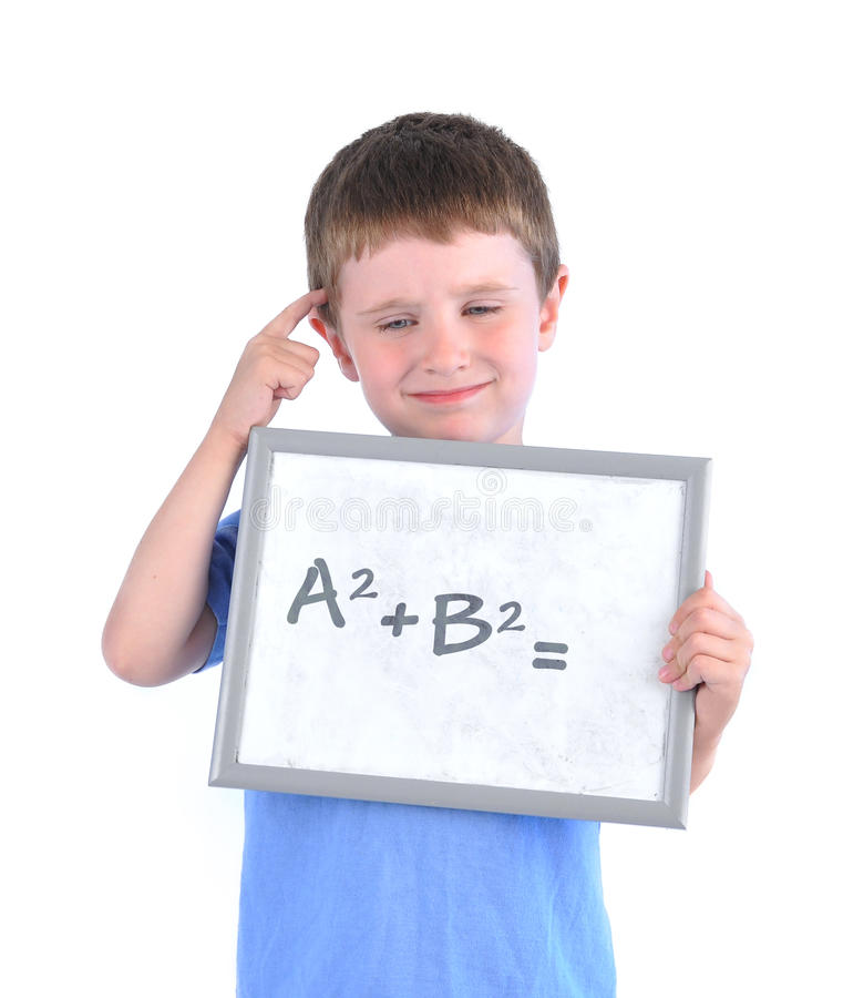 School Boy Thinking About Math Answer. A young boy has a math formula on a board with a blank answer and he is thinking about it on a white isolated background stock photography