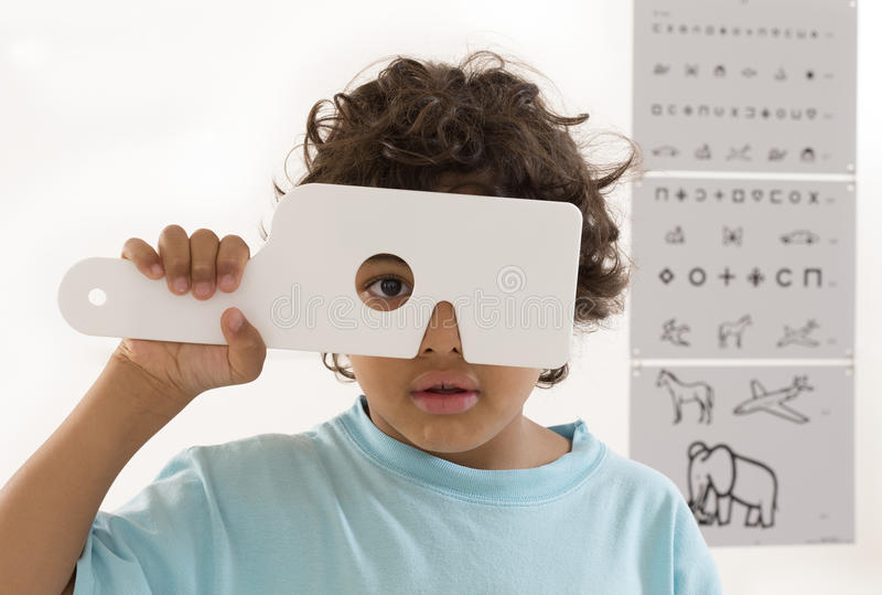 Young boy is having eye exam royalty free stock photo