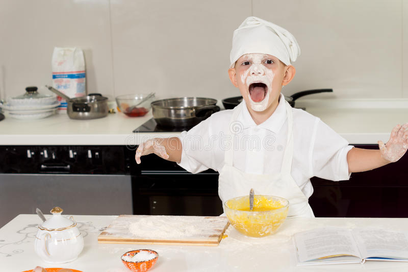 Young boy having fun in the kitchen royalty free stock images