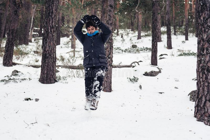 Young boy having fun with snow in the mountain stock photos