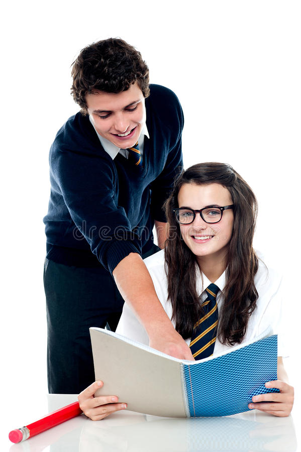Young boy helping his friend and guiding royalty free stock image