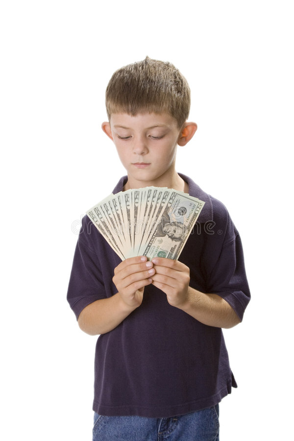 Young Boy Holding Cash Money In Front Of Himself royalty free stock photo