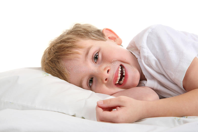 Young Boy holding his lost tooth royalty free stock photos