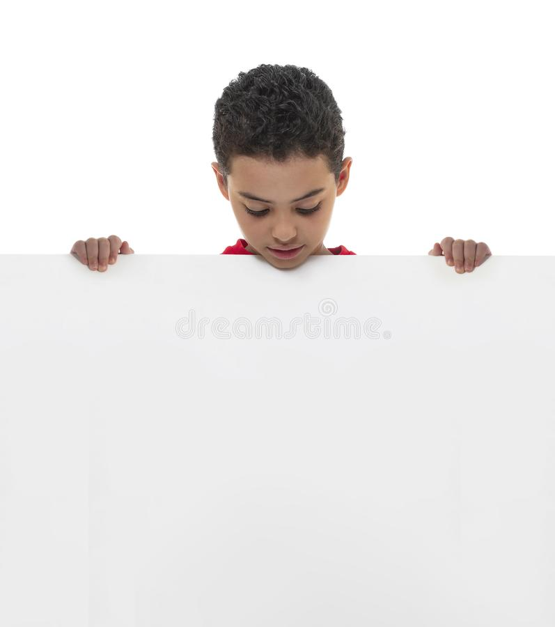 A Young Boy Holding White Board with Copy Space, Advertisement Concept royalty free stock photos