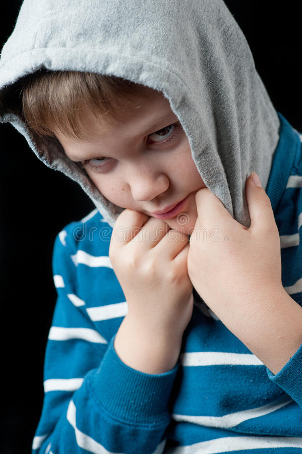 Young Boy with hood on his head royalty free stock image