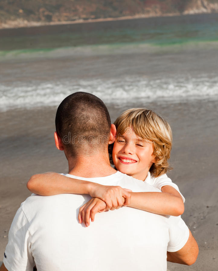 Download Young Boy Hugging His Father Stock Photo - Image: 9373754