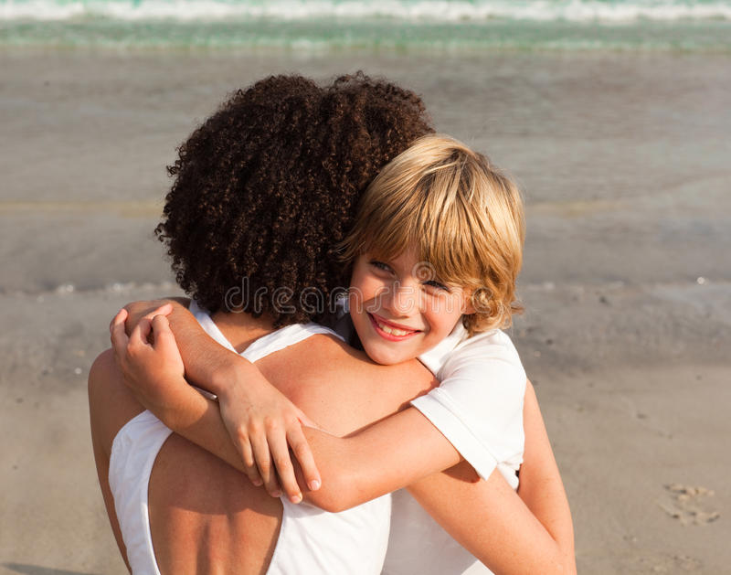 Young Boy Hugging His Mother Royalty Free Stock Photo
