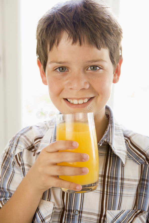 Download Young Boy Indoors Drinking Orange Juice Smiling Stock Image - Image: 5938225