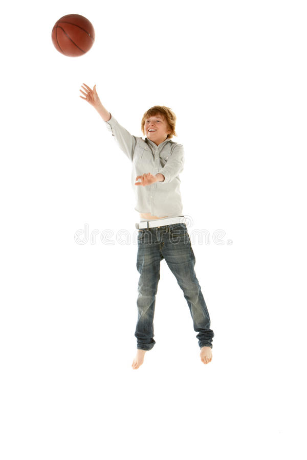 Download Young Boy Jumping With Basketball In Studio Stock Image - Image of white, person: 12988113
