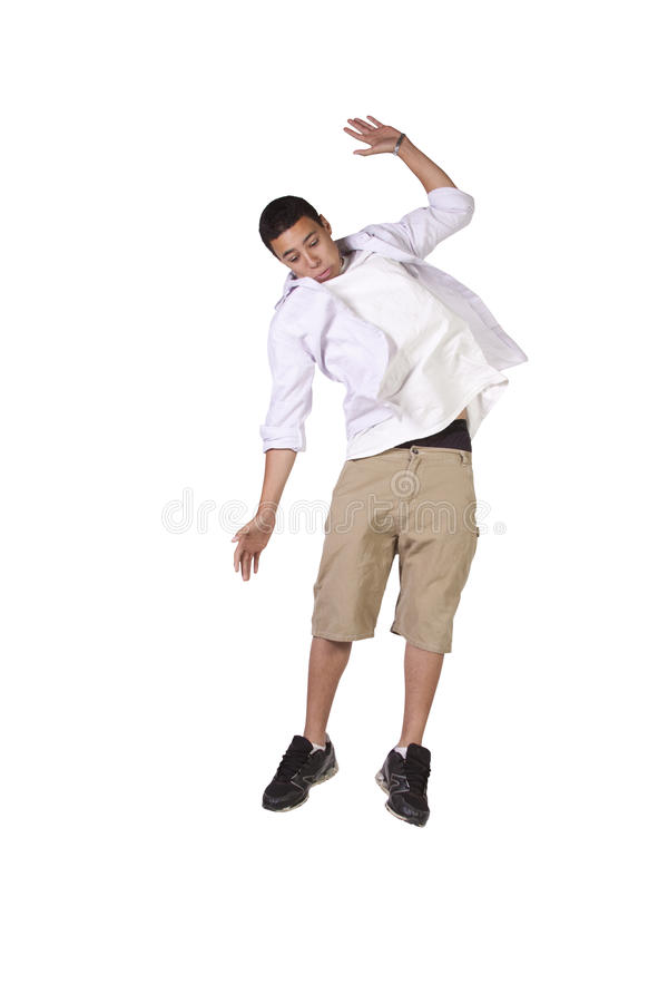 Young boy jumping over white background stock photo