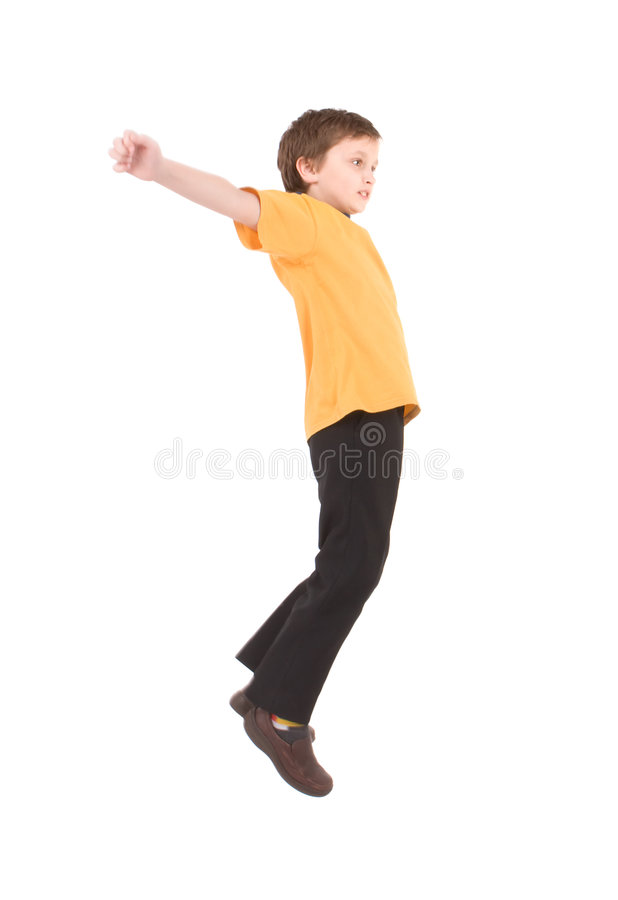 Young boy jumping up stock images