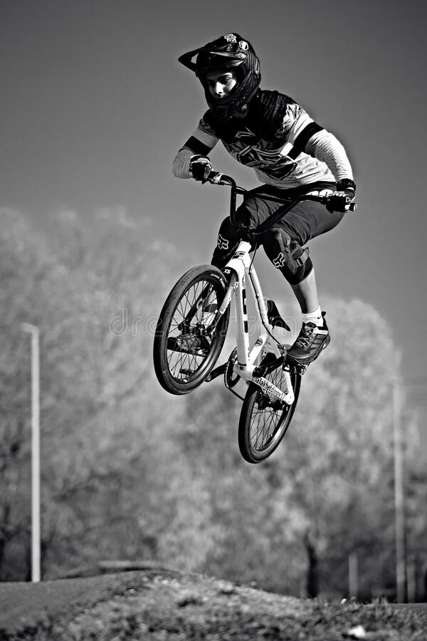 Free Young Boy Jumping With His BMX Bike At Pump Track. BMX Race. Cyclist Riding On Pump Track. Rider In Stock Photos - 180668973