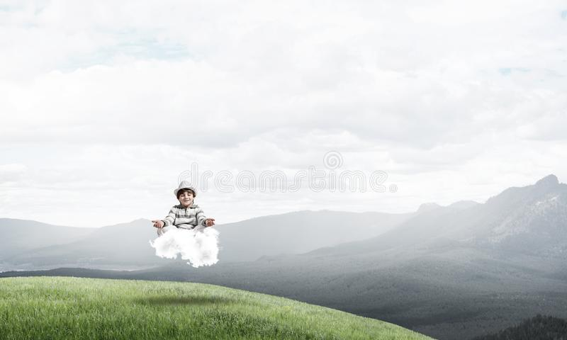 Young boy keeping mind conscious. Young little boy keeping eyes closed and looking concentrated while meditating on cloud in the air with beautiful and royalty free illustration