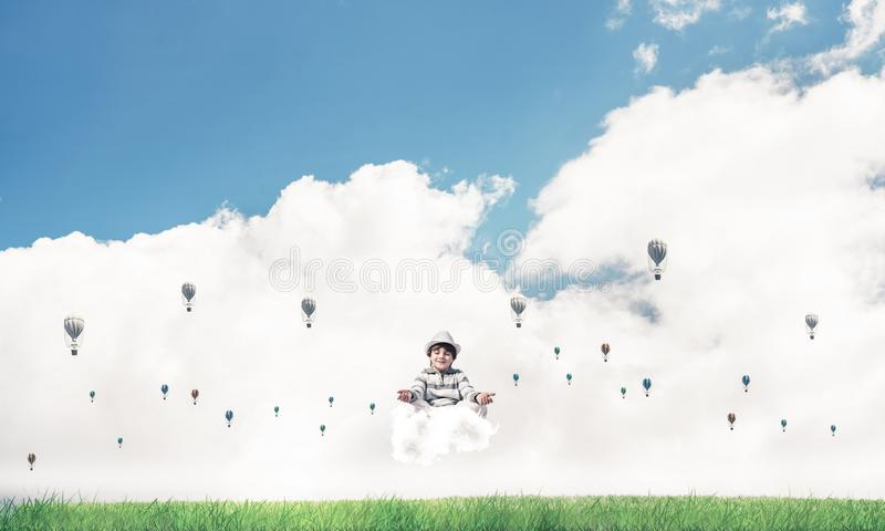 Young boy keeping mind conscious. Young little boy keeping eyes closed and looking concentrated while meditating on cloud among flying aerostats with bright and vector illustration