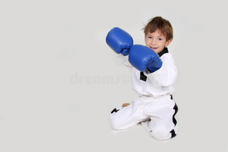 Young boy kickboxing fighter isolated on white royalty free stock image