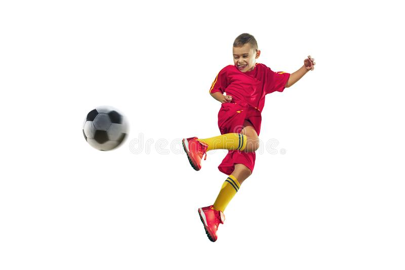 Young boy kicks the soccer ball royalty free stock images