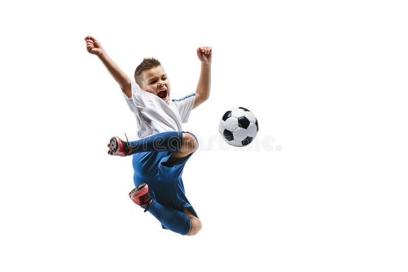 Young boy kicks the soccer ball stock image