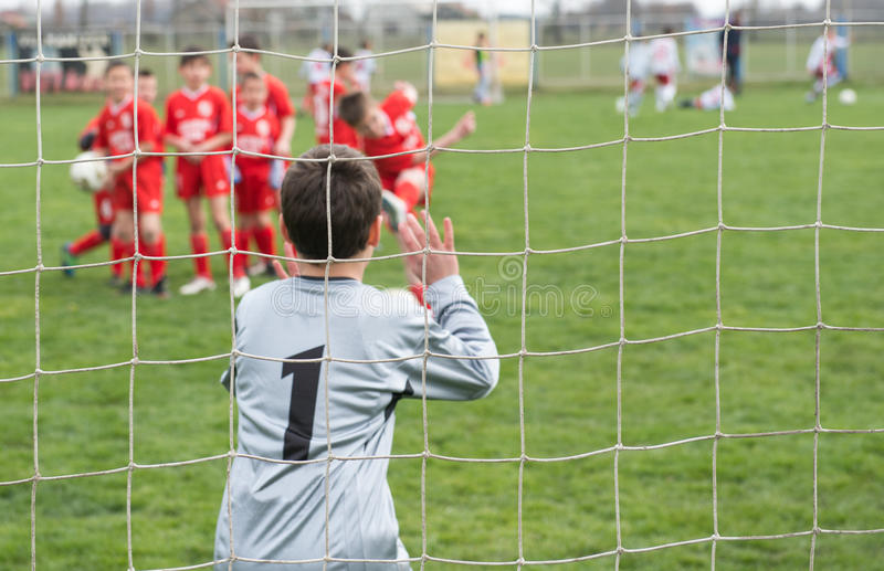 Soccer goalie. Young boy or kid playing soccer goalie royalty free stock image