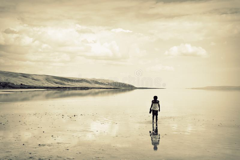 Young boy on the lake, lonely. Young boy on the lake. lonely stock images