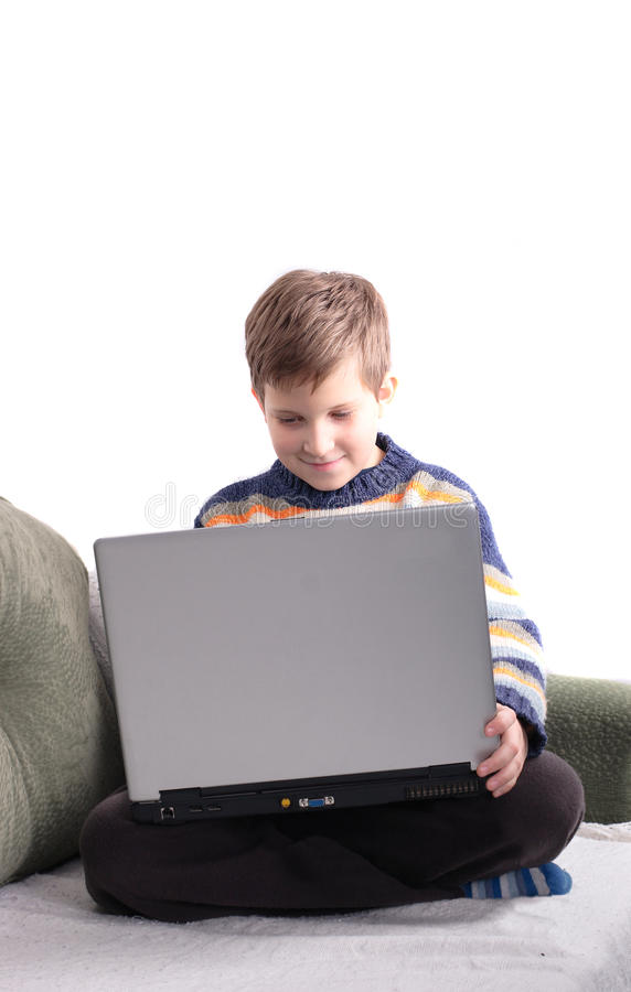 Young Boy With Laptop Stock Images