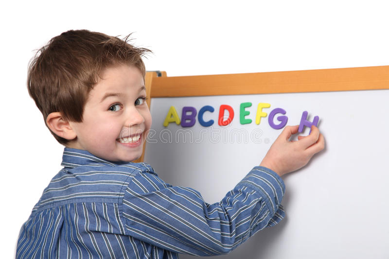 Young boy learning the ABC royalty free stock photos