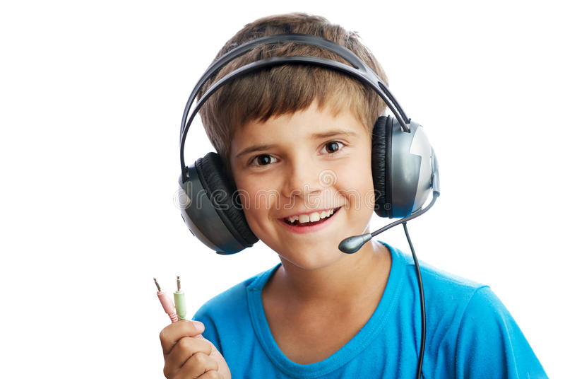 The young boy is listening to music royalty free stock photos