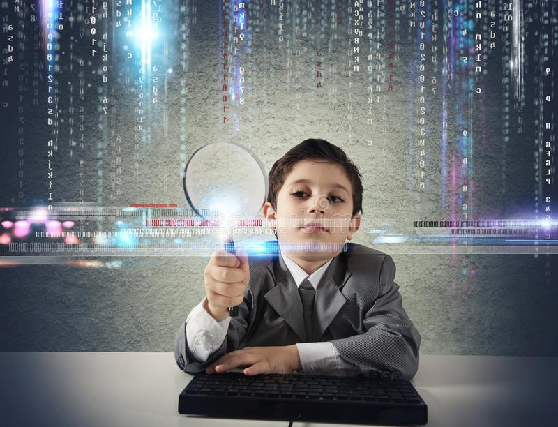 Young boy looking for malicious code stock images