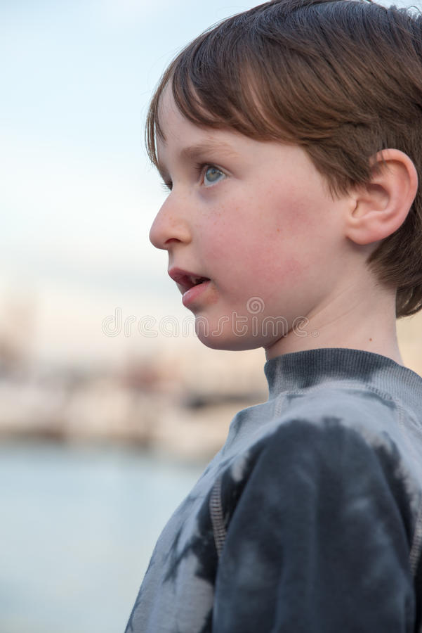 Young boy looking off into the distance. A Young boy looking off into the distance royalty free stock photo